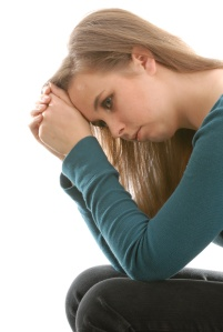 teenage depression - teen woman sitting thinking