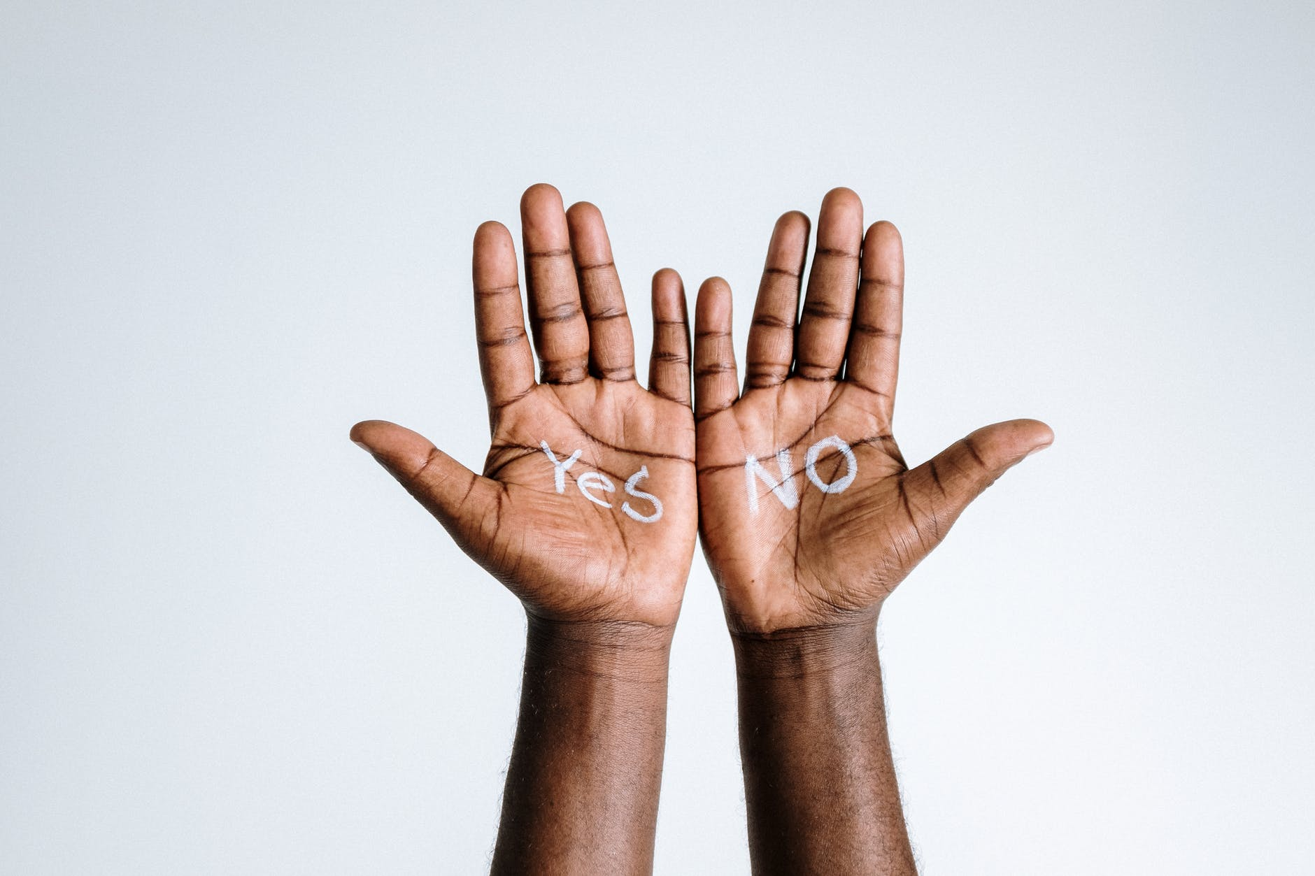photo of person s hand with words